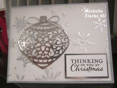 Quick Christmas card using Stampin Up Delicate Ornament Dies and Stamp Set. Silver Cording & Holiday Fancy Vellum shimmers nicely to finish off this card. Michelle Clarke