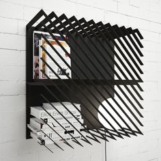 Max Voytenko, of Line Studio, designed a modular bookshelf with graphic, diagonal lines that contain your stuff behind a visually dynamic cage of sorts.