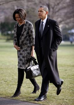 President Obama and First Lady Michelle Obama walk across the South Lawn of the…