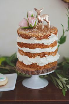 Naked cake | Photography: Scarlet O'Neill Photography - scarletoneill.com Read More: http://www.stylemepretty.com/living/2014/09/18/woodland-inspired-baby-shower/