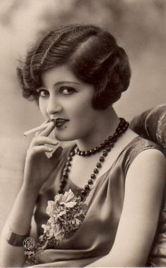 reserved for men for centuries,flappers took up smoking cigarettes ...