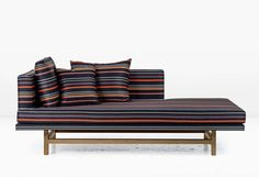 ARAGON CHAISE: OAK LEGS  The Aragon has a powerful asymmetry which directs the view wherever it is placed. Shown in Striped Wool with Fumed White Oak legs. Also available as a sofa, sectional or ottoman.