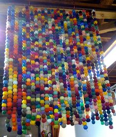 """Yarn ball """"beaded curtain"""".  So colorful and fun.  Maybe for a kids bedroom?  Creative reuse SCRAP SF Gallery. Dia De Los  Muertos decorations"""