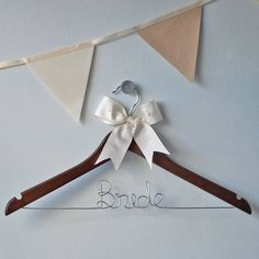 Lovely personalised wedding clothes hanger £16.50 from Clouds and Currents at notonthehighstreet.com