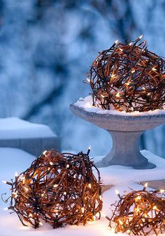 Different idea for Outdoor Christmas Lights wrapped twig branch sphere bundles