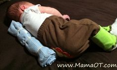 Quick trick: Roll up a receiving blanket to help your baby stay on his side while he's playing or nursing.