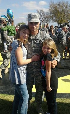 Darla shared this picture of Sgt. Wesley Cox shown here with his daughters during the homecoming of his 4th tour to Iraq. Welcome home Sgt. Cox!