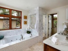 Designer Jodi Fitzpatrick offers helpful tips for turning a bathroom into a modern Zen retreat. Decluttering the shower and simplifying your belongings are just two examples of ways to achieve this transformation.