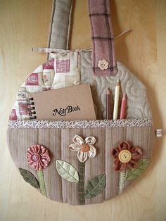 Round Flower Bag - pocket by PatchworkPottery, via Flickr