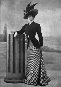 Tailored suit with seamless skirt, by Linker & Co, Les Modes April 1908. This is a typical look in 1900s with small waist, high hip, long skirt mix with white collar and hugging bodice jacket an hat was very fussy