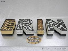 Four individual letters in cheetah, zebra, giraffe and cow animal print http://www.cakescrazy.co.uk/details/letters-shaped-cake-erin-9001.html