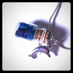 """Mermaid scales with dolphin charm **pendant only** Lovely 1"""" fairy dust bottle filled with """"mermaid scales"""" and finished off with a dolphin charm. This is for the pendant only, chain not included. Handmade. Handmade Jewelry Necklaces"""