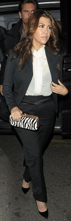 Who made  Kourtney Kardashian's black blazer, black pumps, black pants, white tie top, and zebra print clutch handbag that she wore in London?