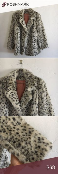 "Vintage Faux Snow Leopard Chubby Coat Fuzziest cozy coat ever!  Stunning vintage shape and an amazing animal print that is neutral enough to go with anything. Silky peach colored lining, two side pockets, and three concealed hook and eye closures at the front. Collar pops up for a chic way block the wind (and feel like a movie star at the same time).  Flat measurements: 31"" from collar to hem, 27"" sleeve, 17"" from shoulder to shoulder, 22"" bust (armpit to armpit) Vintage Jackets & Coats Pea…"