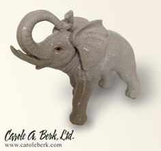 Ceramic crackle glaze elephant. 20 inches wide by 16 inches tall. $295.