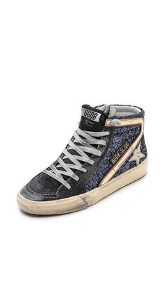 GOLDEN GOOSE Slide Sneakers. Scuffs and dirtied fading create a time-worn patina on skate-inspired Golden Goose high-top sneakers. Glitter-coated and oil-rubbed suede construct the upper. A leather logo accent details the side. Lace-up closure and exposed side zip. Rubber sidewall and sole.  Made in Italy.