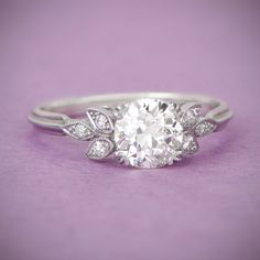 WOW! A gorgeous vintage style engagement ring, accented by a diamond studded floral design. Sold by Estate Diamond Jewelry.
