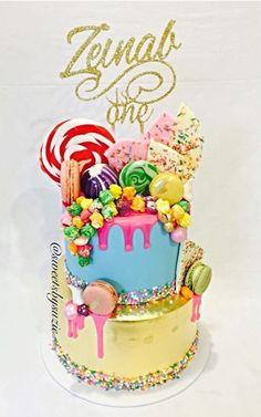 Pink drip girls 1st Birthday cake with gold leaf made by Sweetsbysuzie
