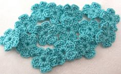 Crocheted Aqua Flowers  Set of 15 by FineThreads on Etsy, $4.50