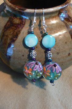 Blue lampwork and blue pearly bead dangle by MarquisCreations, $16.25