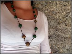 Necklace made of green and gold beads with leather by LaKosta, €8.00