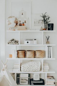 I am obsessed with white decor! The variety in shapes and textures add lots of interest to this shelf.