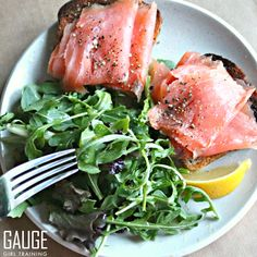 Check out this simple breakfast idea with smoked salmon over gluten free bread with an argula salad lightly sprayed with Kasandrinos Olive Oil (promocode: GAUGEGIRL for 10% off kasandrinos.com) with a squeeze of lemon. For more info on custom meal plans check out gaugegirltraining.com TODAY!