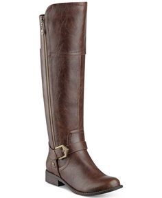 G by Guess' Hailee wide calf riding boots add go-to style to leggings and skirts with strap and buckle details and stretch panels for all-day wear. | Manmade upper; manmade sole | Imported | Round clo