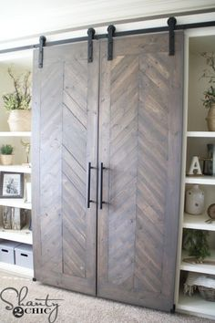 I'm really liking this Sliding Barn Door Media Console. Best part about it? It hides the TV!!!