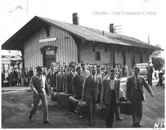 ID#0322 Date: 1942-1945. In this image marines and sailors arrive at the Lake Shore and Southern Michigan depot on South Street. Oberlin College was the site for the Naval Reserve's V-12 training program during World War II; these men are arriving for their training. Participant: Oberlin College Archives. Additional Sources: Pictorial Memories of Oberlin, The Rotary Club of Oberlin, 1976 and 1989.