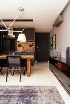 A mix of nrutrals. Black cabinetry, chairs & buffet. Tan table and back splash. Cream floors, walls and lamp shades.