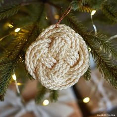 Handcraft DIY ornaments for your Christmas tree this year using our photo tutorial for knotted macrame ornaments. Dress them up with colored dye or glitter!