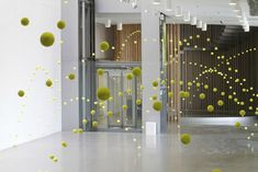 The Matrix by Ana Soler.  Featuring 2,000 tennis balls frozen in mid-air, the installation gives off the illusion that the balls are bouncing of the walls, floors and ceiling of the Mustang Art Gallery in Alicante, Spain.