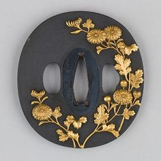 Shakudō tsuba with golden chrysanthemums. ca. 1615–1868 Japan.