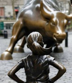 Bronze Sculpture of Small Female Defiantly Faces Charging Bull on Wall Street, http://photovide.com/sculpture-faces-charging-bull/