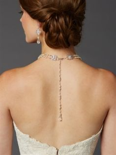 """Picture a plunging open-backed wedding gown enhanced by this graceful pearl and crystal back necklace. Our double row of 5mm pearls and crystals has a sophisticated Audrey Hebpurn look in the front with the unexpected drama of a plunging pearl tail in the back. This best-seller is made even better by the one-of-a-kind 3/4"""" w sterling silver plated filigree and crystal accents which grace the back of the neck. The intricate metal finery accentuates the glamour of this stunning back necklace"""