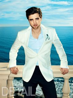 18 Robert Pattinson Pictures That Will Take Your Breath Away. And this one sure does. Would love to see Rob in white more often.