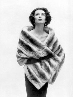 Dorian Leigh is wearing a chinchilla stole from Maurice Kotler, photo by Guy Arsac, 1956