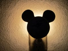 Switch on a cheerful night light. | 33 Perfectly Subtle Ideas For Your Disney-Themed Nursery