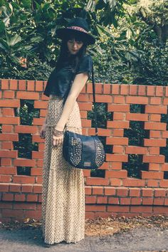 I love the black bag and crop top over the long maxi dress. Perfect styling. Shy Girl Loud Voice: Indifference