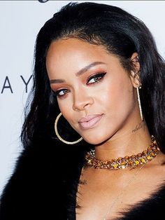 Rihanna long waves with bronze eyeshadow and nude lipstick | allure.com