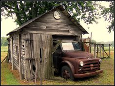 early 50's Dodge truck parked in barn, time stopped
