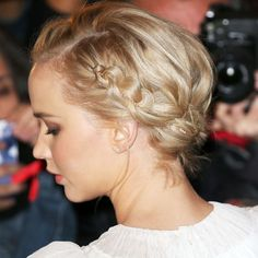 Jennifer Lawrence does subtle bling with a dainty necklace woven through her milkmaid braid updo