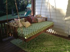Pallet swing made by my husband and uncle sal. Twin bed size with anthro looking pillows.