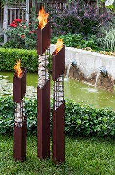 The Mason outdoor torches are constructed of heavy gauge, welded steel and natural stone. The stepped height of each torch is intentionally engineered to lend harmony to any design aesthetic. Heavy, earth-tone, powder-coating is engineered to provide year Outdoor Torches, Outdoor Fire, Tiki Torches, Garden Yard Ideas, Diy Garden Decor, Garden Decorations, Gabion Wall, Outdoor Lighting, Outdoor Decor
