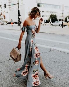 And off the shoulder maxi dress in a light pale bluish gray with floral print. Looks absolutely gorgeous split up the side of the skirt. Stunning purse and high heels make this dress