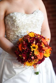 The warm, rich colors of a fall inspired bouquet for Walt Disney World bride, Elyse.