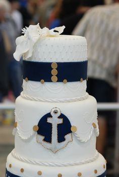 wedding cake :: nautical theme. with the yellow calla flower on top and yellow instead of gold