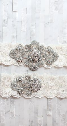 Hand selected crystal bridal buttons and brooches adorned on vintage inspired blue hand beaded trimmings layered on French imported lace. Comes with matching toss as shown in the picture.