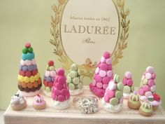 How about a Laduree' Macaroon Tower? (Who dares to be the first to take one off & eat it?!)  #holidayentertaining